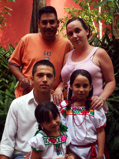Margaret Acuitlapa, top right, her husband Jose, top left, and their three children. The Acuitlapas decided to move their mostly American family to Mexico in order to stay together after Jose was deported.